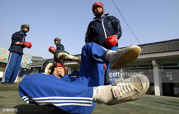 A student training in the art of Xingyi Quan drops his opponant at the famed Shaolin Monestary in Henan province in central China 03 November 2004...