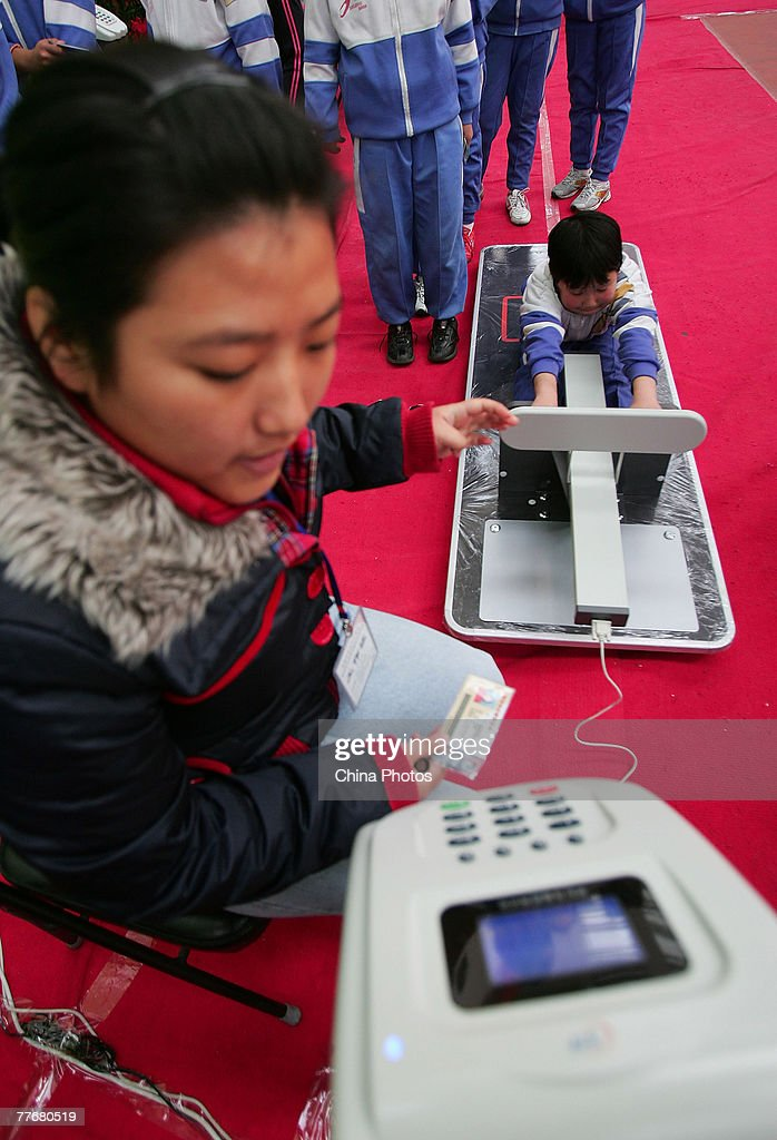 A student undergoes a sit-and-reach test during an examination in a