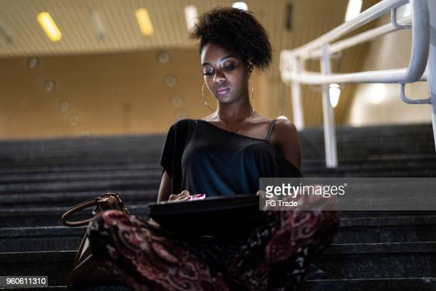 student university sitting on the stairway - black purse stock pictures, royalty-free photos & images