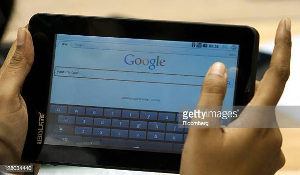 A student uses the 'Aakash' tablet computer to search the Google web page during a news conference in New Delhi India on Wednesday Oct 5 2011 India...