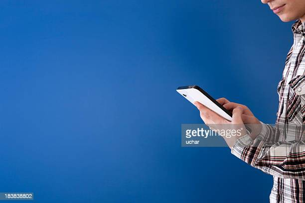Student using a tablet with blue background