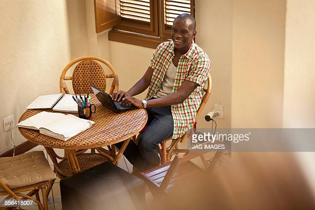 Student using laptop at dining table