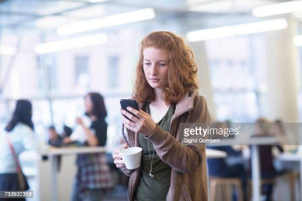 Student using mobile phone in library