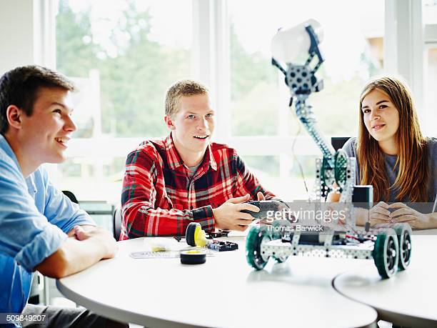 Student using remote control to operate robot