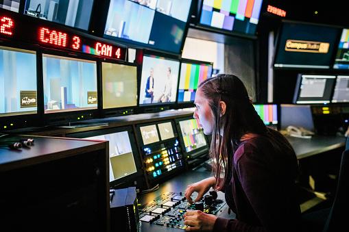 Student Using TV Studio Equipment 1127729281