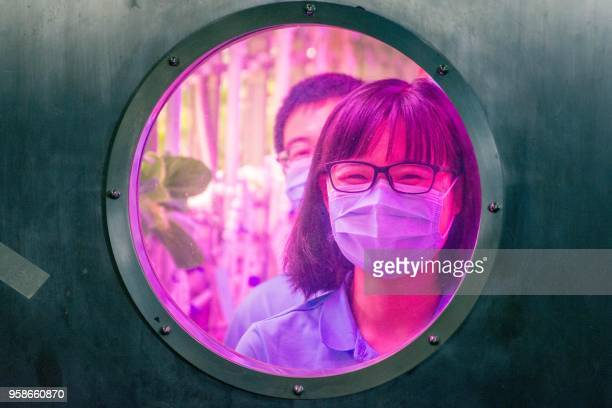 Student volunteers are seen inside the Lunar Palace 1 a laboratory simulating a lunarlike environment as they prepare to leave the site in Beijing on...