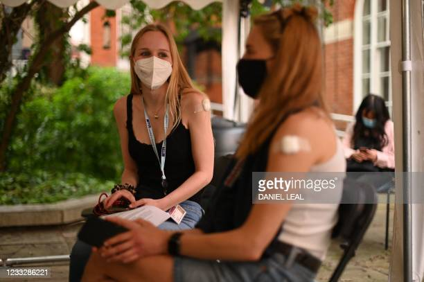 Student waits before leaving after receiving a dose of the Pfizer/BioNTech Covid-19 vaccine at a vaccination centre at the Hunter Street Health...