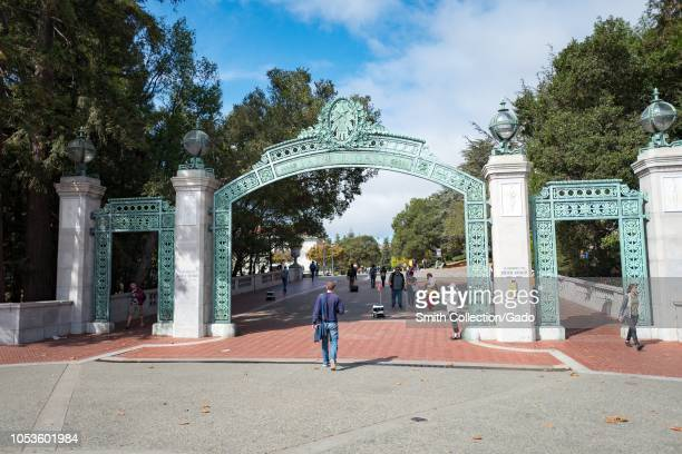 Student walk through Sather Gate the iconic entrance gate to the campus of UC Berkeley in downtown Berkeley California October 9 2018