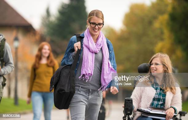 Student Walking Beside A Friend With Disability