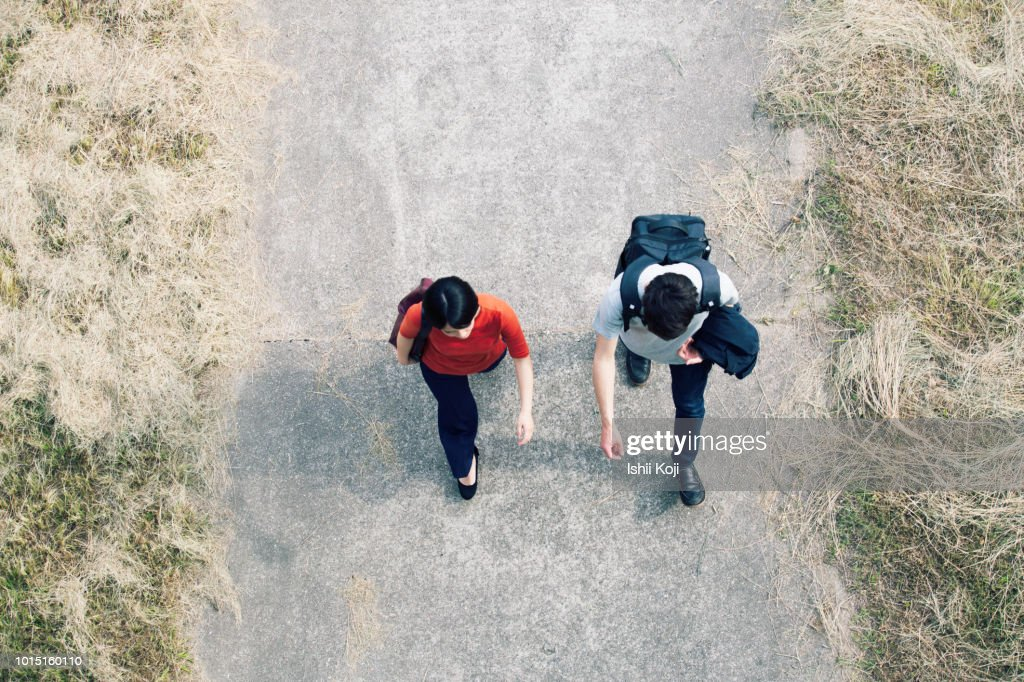 Student walking from directly above : Stock Photo