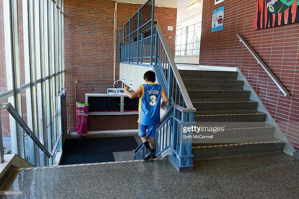 A student walks down a set of steep stairs at Clayton
