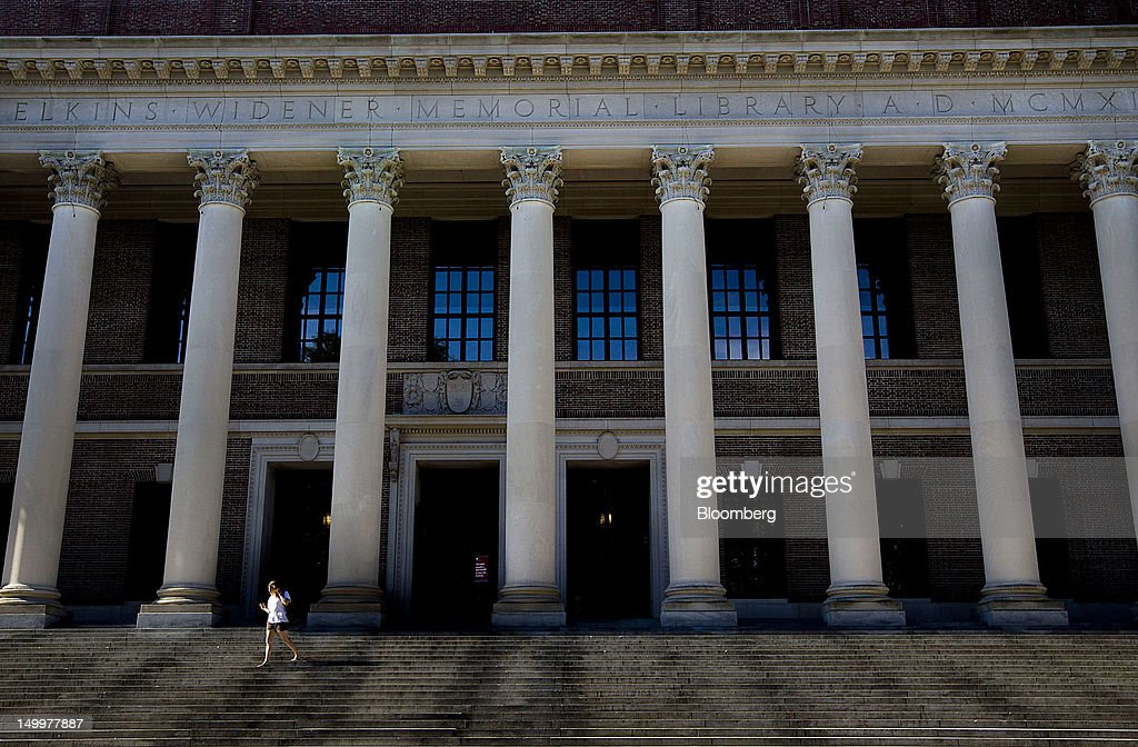 A student walks down steps of the Harry Elkins Widener Memorial Library at Harvard University in Cambridge, Massachusetts, U.S., on Monday, Aug. 6, 2012. Harvard University, an American private Ivy League research university established in 1636, is the oldest institution of higher learning in the United States and the first corporation chartered in the country. Photographer: Brent Lewin/Bloomberg via Getty Images