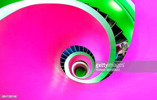 A student walks down the stairs in a staircase of the 'Informations Kommunikations und Medienzentrum library in Cottbus eastern Germany on May 17...