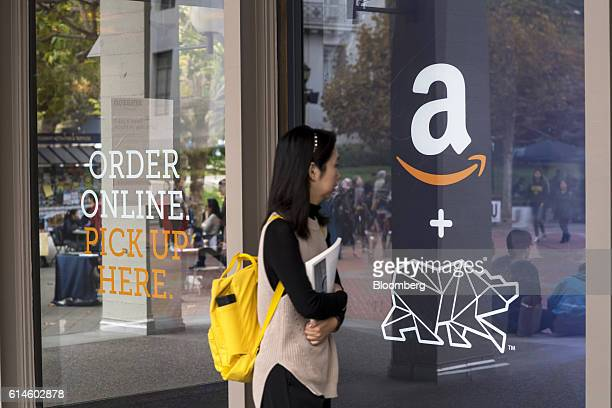 A student walks in front of an Amazoncom Inc kiosk on the University of California Berkeley campus in Berkeley California US on Wednesday Oct 12 2016...