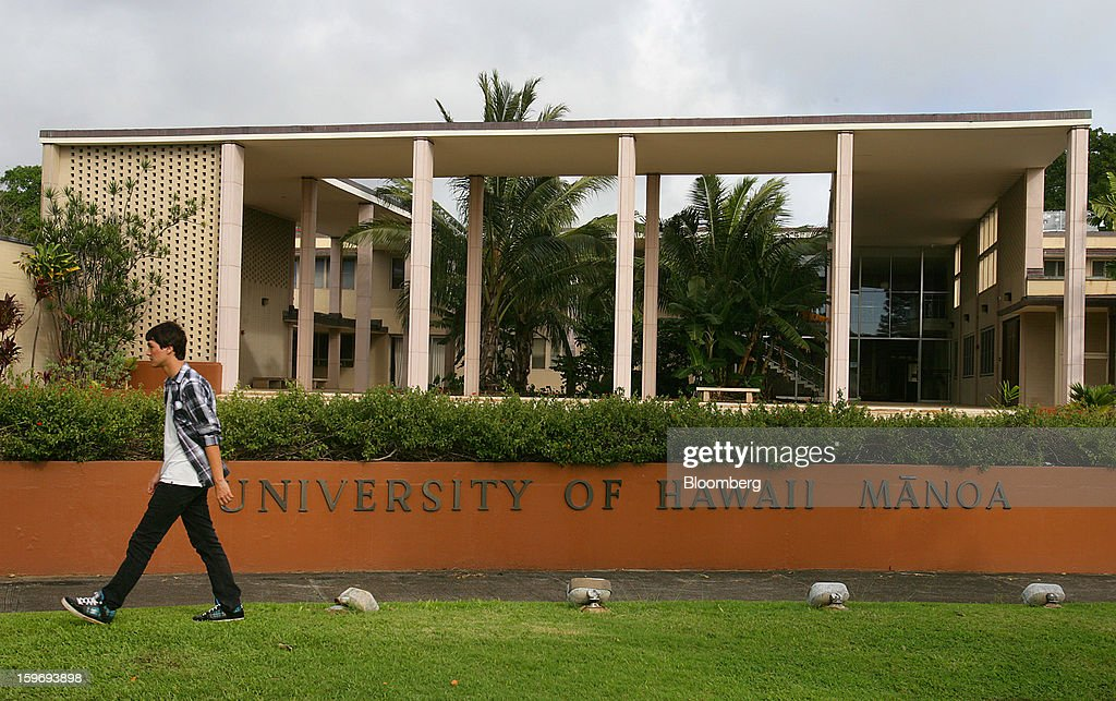 A student walks on campus at the University of Hawaii in Honolulu, Hawaii, U.S., on Wednesday, Jan. 9, 2013. Honolulu, the southernmost major U.S. city, is a major financial center of the islands of the Pacific Ocean. Photographer: Tim Rue/Bloomberg via Getty Images