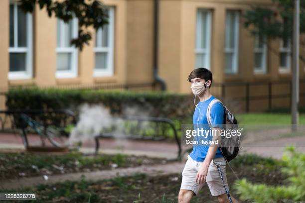 Student walks on campus at the University of South Carolina on September 3, 2020 in Columbia, South Carolina. During the final week of August, the...
