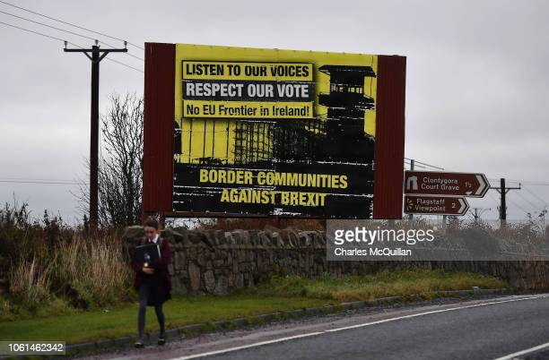 A student walks past a Border Communities Against Brexit sign on November 14 2018 in Newry Northern Ireland Prime Minister Theresa May is locked in...