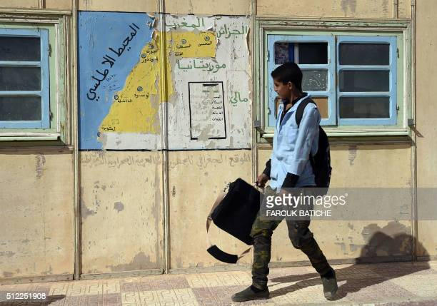 A student walks past a map at a school in the Smara refugee camp in Algeria's Tindouf province on February 25 2016 The Western Sahara is a territory...