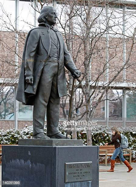 Student walks past a statue of Brigham Young on the campus of Brigham Young University on March 1, 2012 in Provo, Utah. BYU is the alma mater of...
