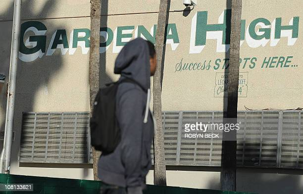 Student walks past the entrance t9 Gardena High School in Gardena, California January 18, 2011 after two students were shot, one in the head, when a...
