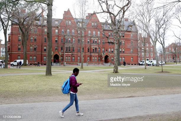 Student walks through Harvard Yard on the campus of Harvard University on March 12, 2020 in Cambridge, Massachusetts. Students have been asked to...