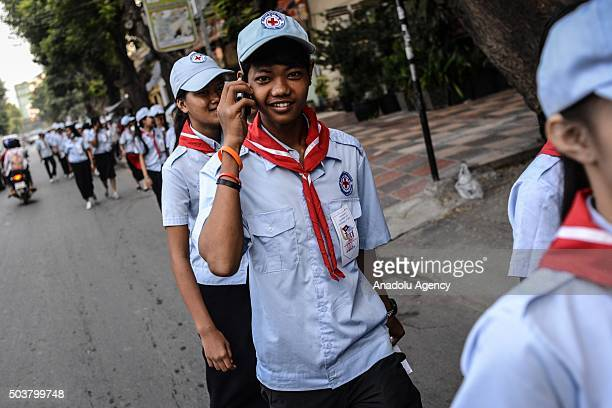 Student walks to the headquarters of the Cambodian People's Party to celebrate Victory Against Genocide Day in Phnom Penh, Cambodia, on January 7,...
