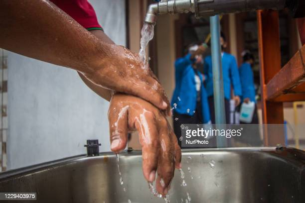 Student washing his hands before taking classes at Islamic boarding school of Al Uswah in Semarang, Central Java Province, Indonesia, on November 01,...
