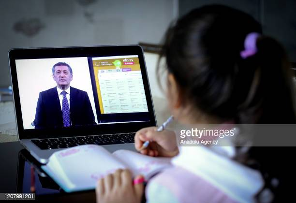 A student watches Turkish National Education Minister Ziya Selcuk from the laptop at her house as the Minister giving a first lecture of distance...