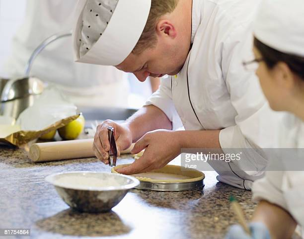 Student Watching Instructor in Culinary School