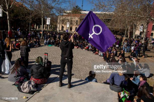 A student waves a feminist flag during a gathering during the International Women's Day on March 08 2019 in Getafe near Madrid Spain Spain celebrates...