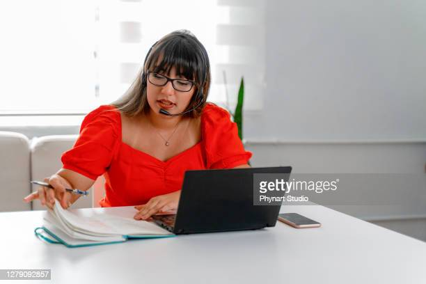 student wear headset study online teacher write notes - translation stock pictures, royalty-free photos & images