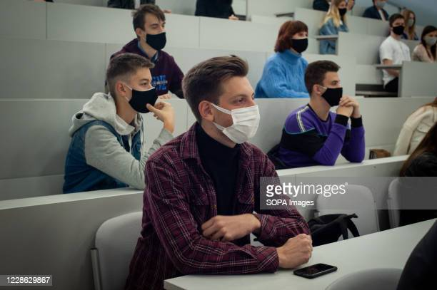 Student wearing a face mask as a precaution. High school students from various schools in Tambov at an additional lesson and practical seminar on...