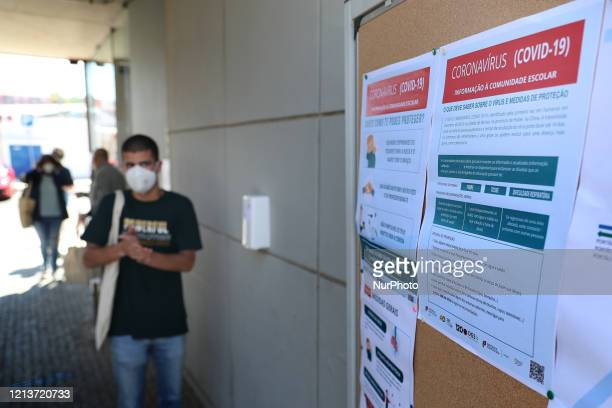 A student wearing a face mask gets his hands disinfected on the first day of school after the relief of emergency measures due to the COVID19...