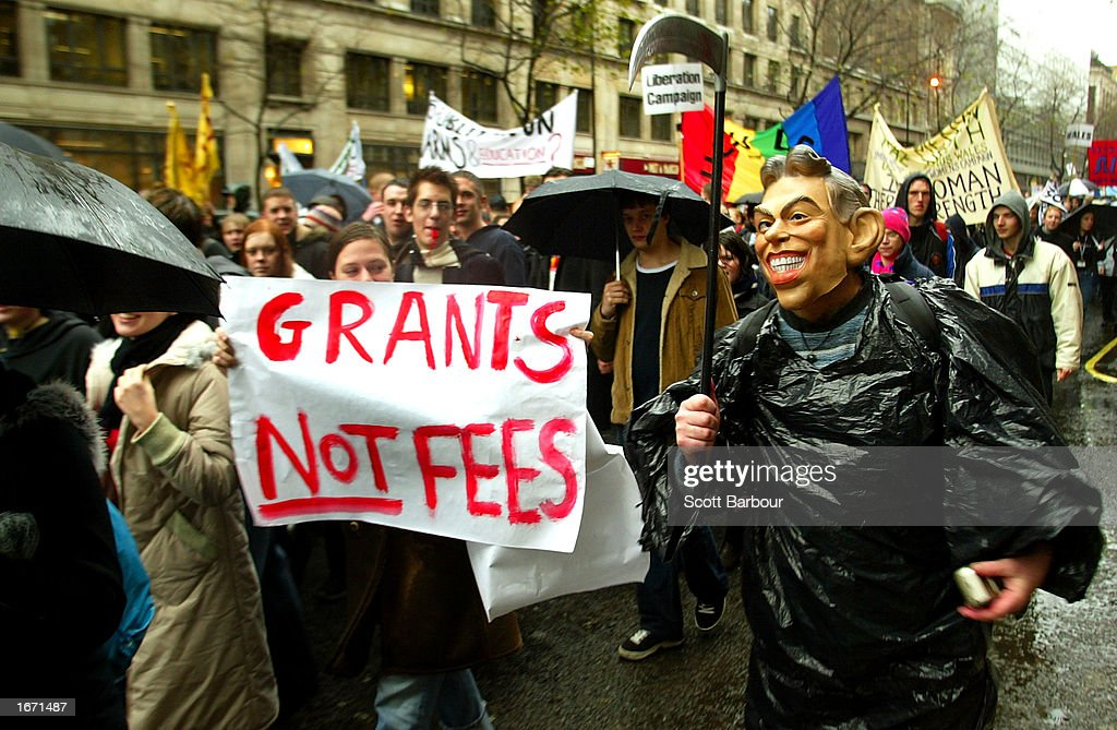 A student wearing a mask of British Prime Minister Tony Blair (R) participates in a demonstration December 4, 2002 in London, England. Thousands of students marched through the streets of London to protest against student debt and any increase in fees.