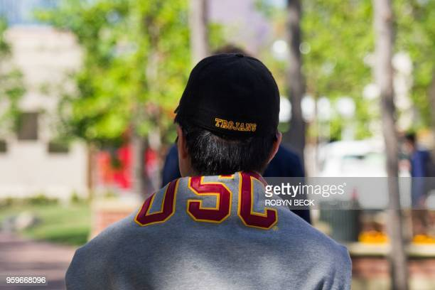A student wearing a USC sweatshirt over his shoulders walks on the University of Southern California in Los Angeles California on May 17 2018 USC was...
