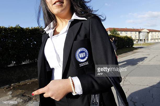 A student wearing an uniform with a school crest waks to a building of her Excellence boarding school on March 5 2012 in Sourdun eastern Paris...