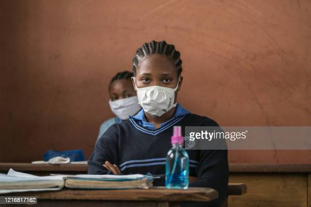 Student wears a face mask as a preventive measure against the spread of the COVID-19 coronavirus in the classroom at the Jean Benoit College in...