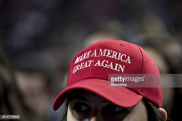 A student wears a 'Make America Great Again' campaign as Mike Pence 2016 Republican vice presidential nominee not pictured speaks at a Liberty...