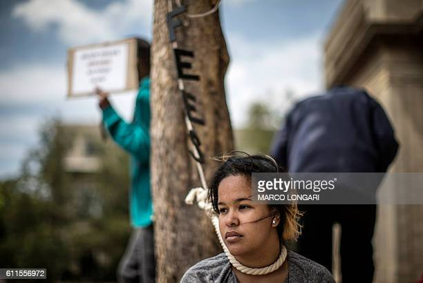 TOPSHOT A student wears a noose around her neck as lecturers and staff of Witwatersrand University demonstrate in support of the free education...