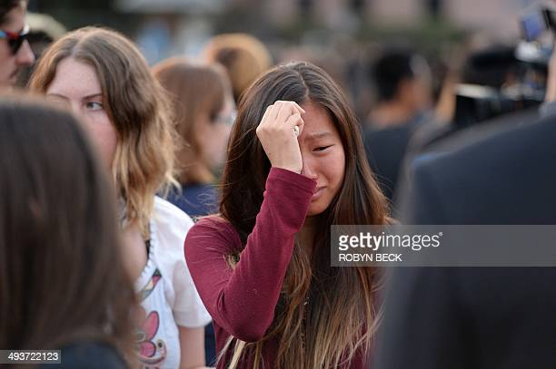 Student weeps during a candlelight vigil on May 24, 2014 for those affected by a killing spree in Isla Vista, on the University of California Santa...