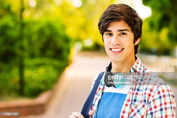 student with headphones around neck on campus - 18 19 years stock pictures, royalty-free photos & images