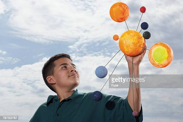 Student with Model Solar System