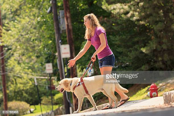 Student with visual impairment directing her service dog to turn