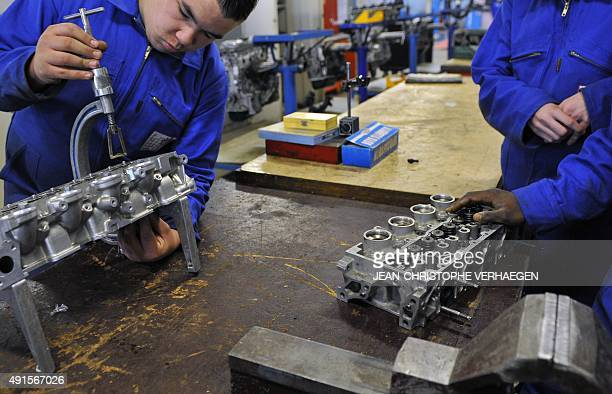 Student work on a motor on October 5 2015 at the Andre Citroen high school specialized in automotive trades on October 5 2015 in Marly eastern France...