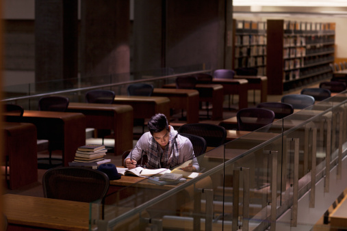 Student working in library at night - gettyimageskorea