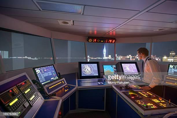 Student working in ship's bridge simulation room during night scene