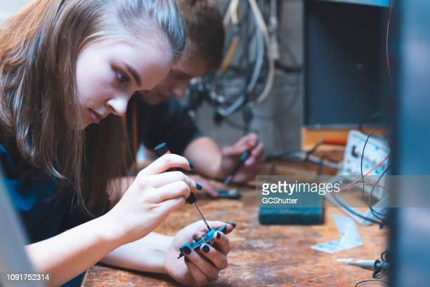 student working in their lab together. - cleveland stock pictures, royalty-free photos & images