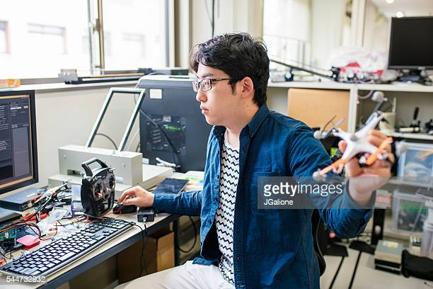student working on his drone design - remote control stock pictures, royalty-free photos & images