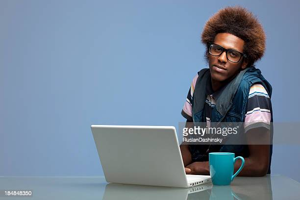 student working on laptop computer. - thick rimmed spectacles stock photos and pictures