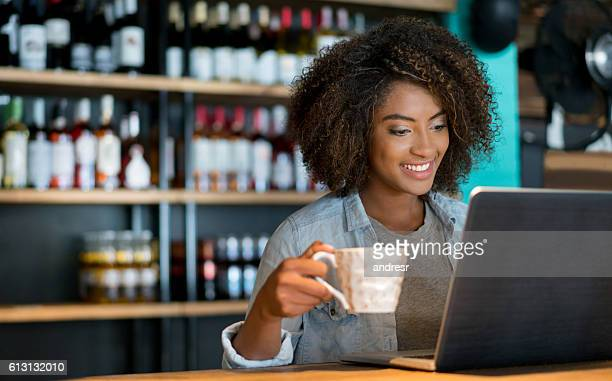 Student working online at a cafe